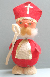 "1: In Europe he is called « Sint Niklaas ». During the night of December 5th-6th he brings presents. In olden days he rode on a donkey on the rooftops, accompanied by ""Zwarte Piet"" (black Pete) and came in the house through the chimney. Children put a shoe, slipper or a clog filled with a carrot and a turnip for the donkey in front of the fireplace."
