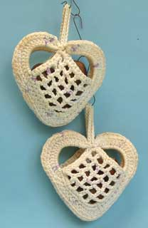 42: two crocheted heart shaped bags.