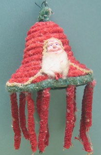 Santa with papier maché face on a paper & chenille bell.