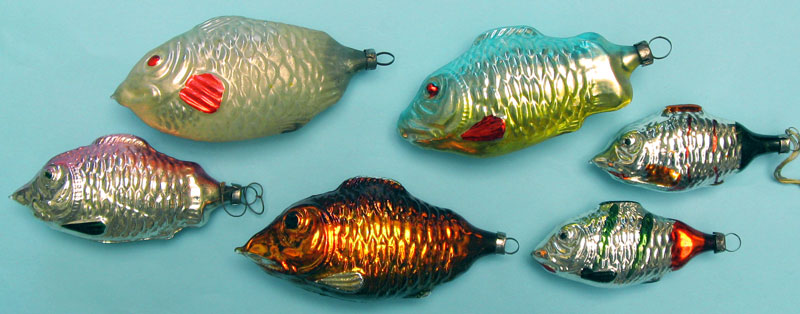 Fish with standard cap; top left being the  oldest, pre-WW2; between 9.5 and 6.5cm.
