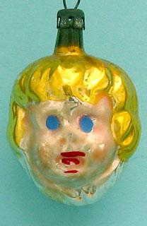 Small, 4.5cm, girl's head, resembles the poor Ajeko molding  but it is not..