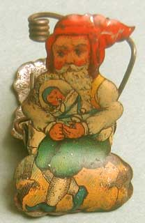 Gnome (sometimes called Santa, but I think it is a gnome) holding a child. The next photo is the other side of this clip; different sides is unusual.