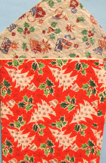 "10:Two different wrapping papers; in the margin of the red one ""A DENNISON PRODUCT"" and ""PRINTED IN ENGLAND""."